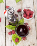 Raspberry Treacle. In a glass on vintage weathered wooden background Stock Images