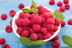 Raspberry on turquoise background Royalty Free Stock Photo