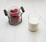 Raspberry vintage ware on a wooden board Royalty Free Stock Photo