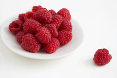 Raspberry on the white plate Stock Photography