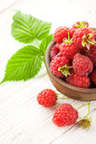 Raspberry on a white wooden table Royalty Free Stock Photos