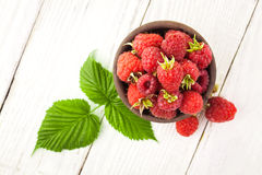 Raspberry on a white wooden table Stock Images