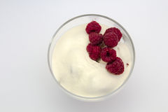 Raspberry witth sauer cream, in isolated white background Royalty Free Stock Image