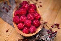 Raspberry in wood bowl Stock Photo