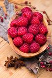 Raspberry in wood bowl Stock Image