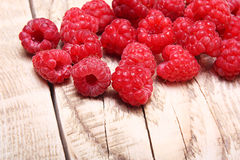 Raspberry on wooden background Stock Images