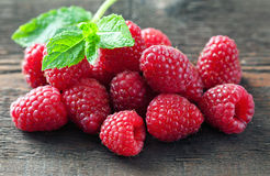 Raspberry. On a wooden background selective focus royalty free stock image