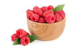 Raspberry in a wooden bowl isolated on a white background.  Royalty Free Stock Photo