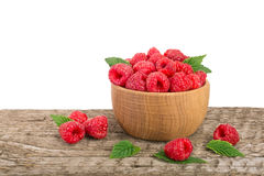 Raspberry in a wooden bowl on table with white background.  Stock Image