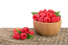 Raspberry in a wooden bowl on table with white background.  Royalty Free Stock Images