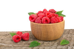 Raspberry in a wooden bowl on table with white background.  Royalty Free Stock Photos