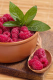 Raspberry in wooden plate. Photo for a design Stock Images
