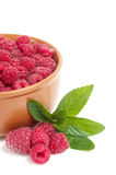 Raspberry in wooden plate. Photo for a design Royalty Free Stock Image