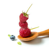 Raspberry in wooden spoon. And blueberri on  white background Stock Photography