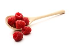 Raspberry in wooden spoon Royalty Free Stock Image