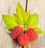 Raspberry on wooden table Stock Photography