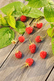 Raspberry on wooden table Stock Photos
