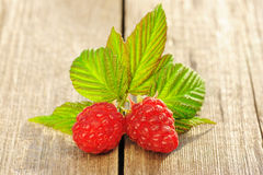 Raspberry on wooden table Royalty Free Stock Image