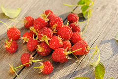 Raspberry on wooden table Stock Images