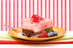 Raspberry yoghurt cake garnished with berries Royalty Free Stock Images