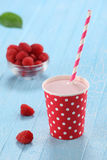 Raspberry yogurt cup with a straw Royalty Free Stock Photo