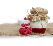 Raspberry yogurt and jam. Photo of fresh raspberry jogurt and jam in a glass with white space for text Stock Photos