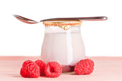 Raspberry yogurt with a spoon Stock Images