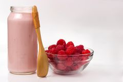 Raspberry yogurt with raspberry and a wooden spoon.  Stock Photography