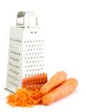 Raspel und Karotten lizenzfreies stockbild