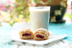 Rasperry pastry treats with glass of almond milk for breakfast Stock Photos