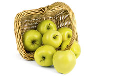 Raspy yellow apples. Ripped yellow apples from a basket with a handle Royalty Free Stock Photo