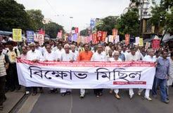 Rassemblement de protestation contre des fonds Scam de note Photographie stock