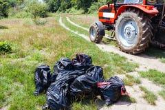 Rassemblement des sacs de déchets Images libres de droits