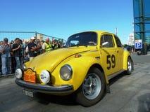 Rassemblez Pékin à Paris 2013, Kharkov, la voiture jaune 59 Photo libre de droits
