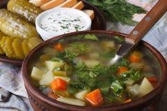 Rassolnik soup with cucumber closeup on the table. horizontal Stock Photo