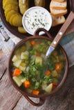 Rassolnik soup with cucumber closeup top view Stock Image