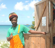 Rasta craftsman on beach Carriacou Grenada stock images