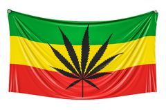 Rasta Flag, Cannabis leaf on Rastafarian flag hanging on the wal Royalty Free Stock Image