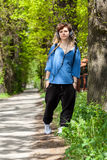 Rasta girl walking and listening reggae Stock Images