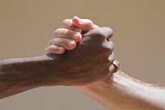 Rasta grip. A black man and a white man greeting in a rasta grip royalty free stock photography