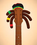 Rasta Guitar. Ready to reggea with the long rasta hairs and the rastacap Royalty Free Stock Photo
