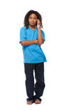 Rasta kid making a call in studio Royalty Free Stock Photography