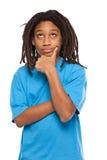 Rasta kid thinking in studio Royalty Free Stock Image