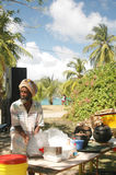 Rasta man cooking beach Bequia stock images