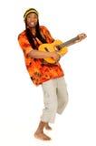 Rasta reggae guy. Handsome Caribbean, humorous African American Rasta reggae guy with guitar. Studio, white background royalty free stock photography