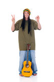 Rasta reggae guy. Handsome Caribbean, humorous Rasta reggae guy with joint and guitar. Studio, white background royalty free stock images
