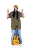 Rasta reggae guy. Handsome Caribbean, humorous Rasta reggae guy with joint and guitar.  Studio, white background Royalty Free Stock Images