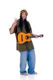 Rasta reggae guy. Handsome Caribbean, humorous Rasta reggae guy with joint and guitar. Studio, white background stock images