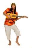 Rasta reggae guy. Handsome Caribbean, humorous African American Rasta reggae guy with guitar. Studio, white background stock photos
