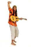 Rasta reggae guy. Handsome Caribbean, humorous African American Rasta reggae guy with guitar. Studio, white background stock photography